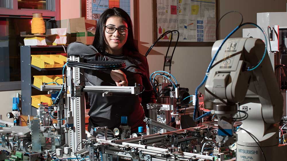 A student in Pennsylvania works on a mechatronics project.