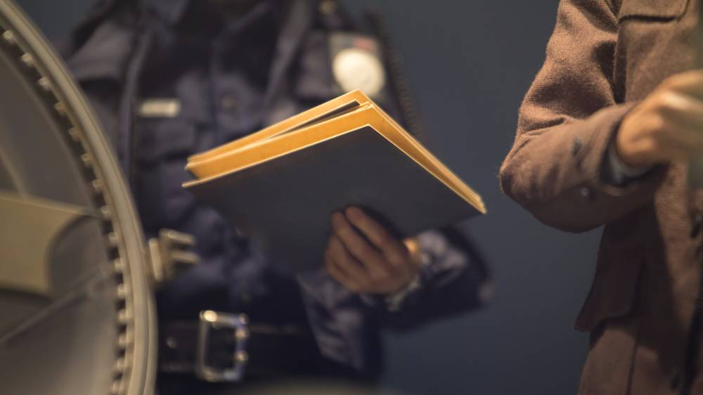 A police officer holds a folder