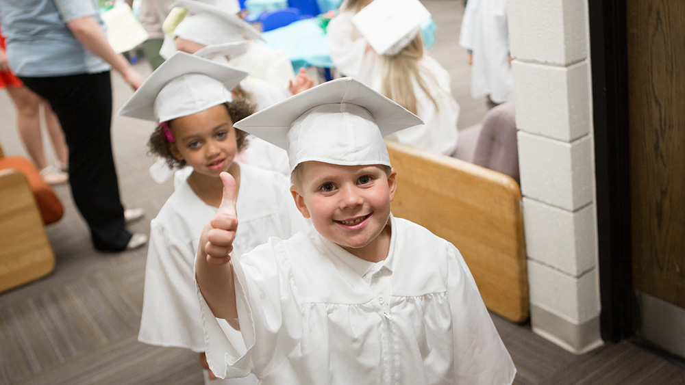 Children graduate from preschool.