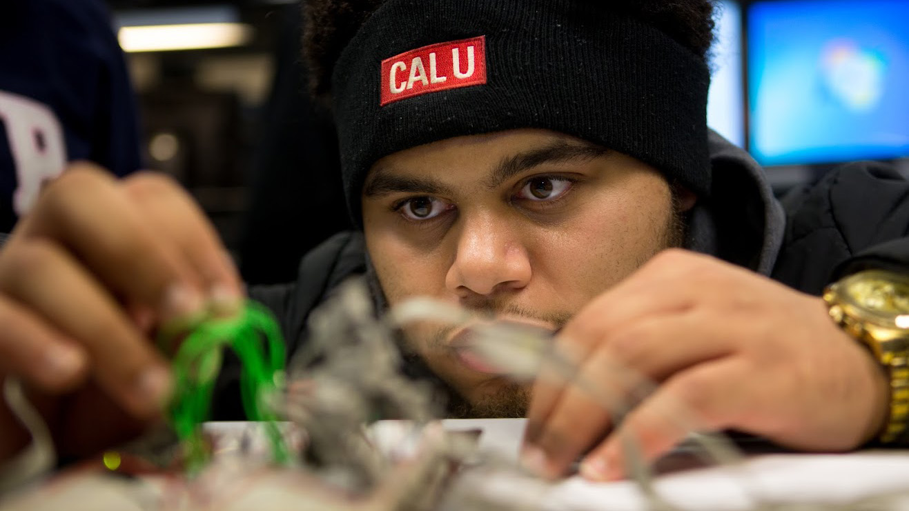 An applied engineering student participates in an electrical engineering course.