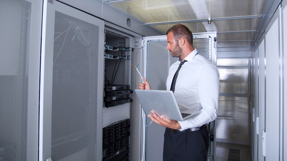 A student checks a server during an internship.