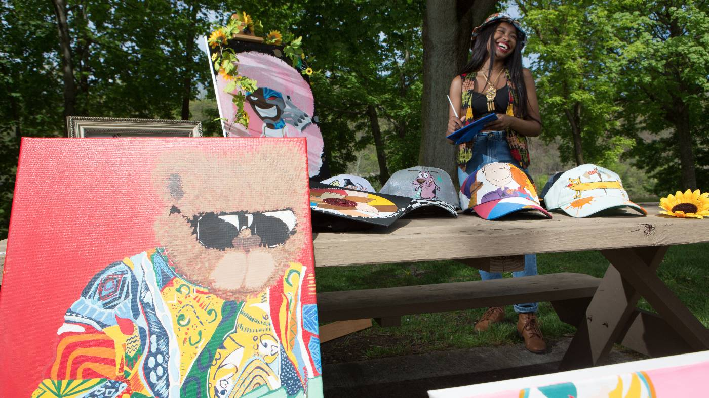 A student sells art on campus.