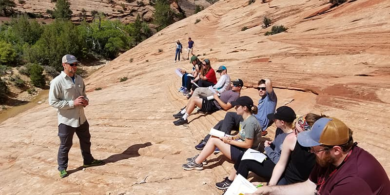 Students lean geology in field course.