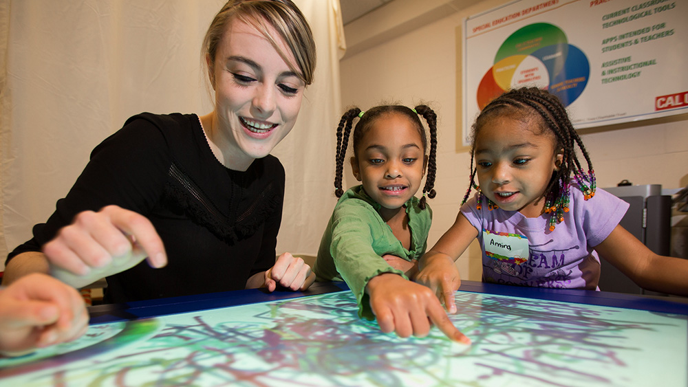 A Cal U student teaches children in a classroom.