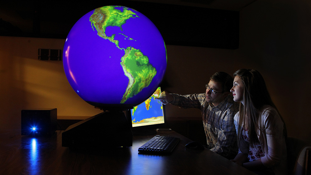 Meterology students use a digital globe to simulate weather patterns.
