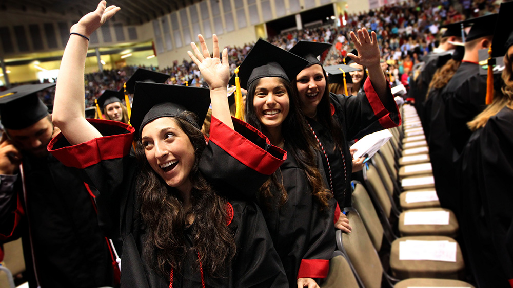 Cal U students celebrate becoming graduates at their graduation ceremony.