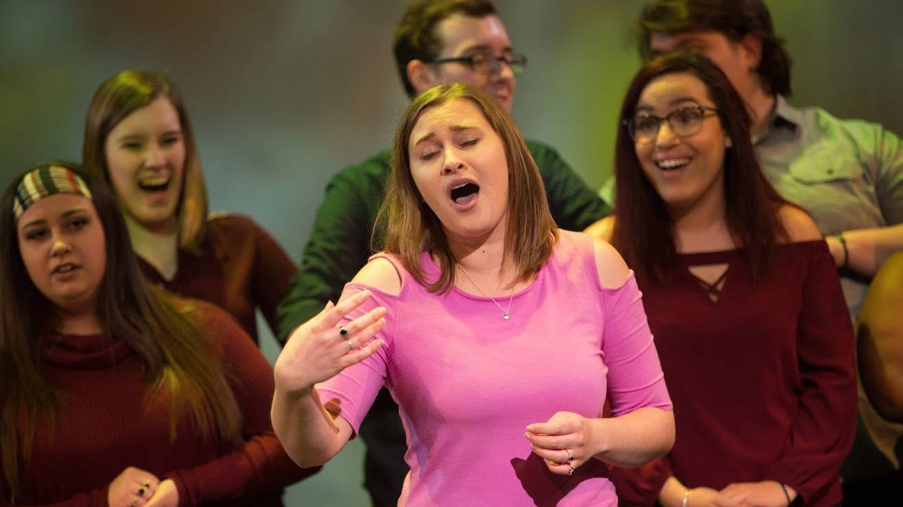 A musical theater major sings during a Cal U performance.