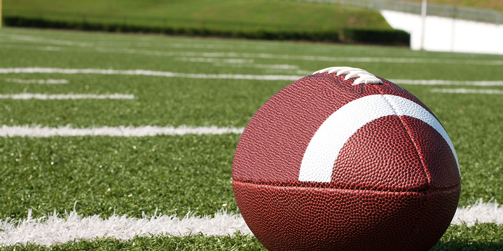 A football rests on the field.