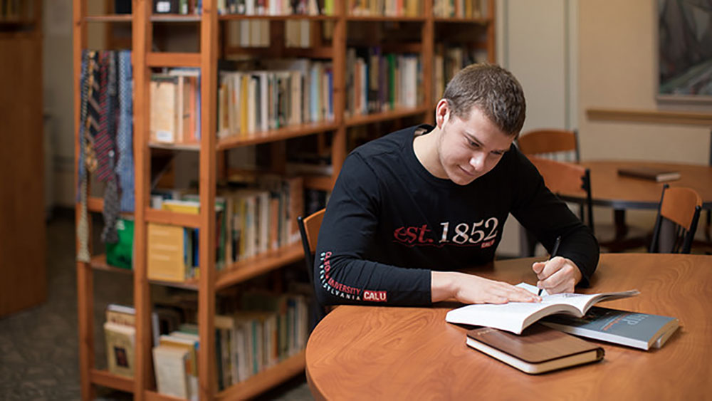 A student works on a project in the Writing Center.
