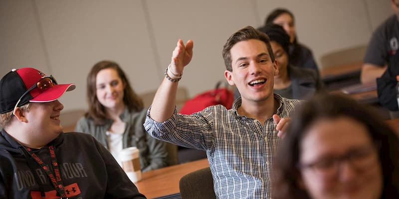 A student speaks in a classroom at Cal U.