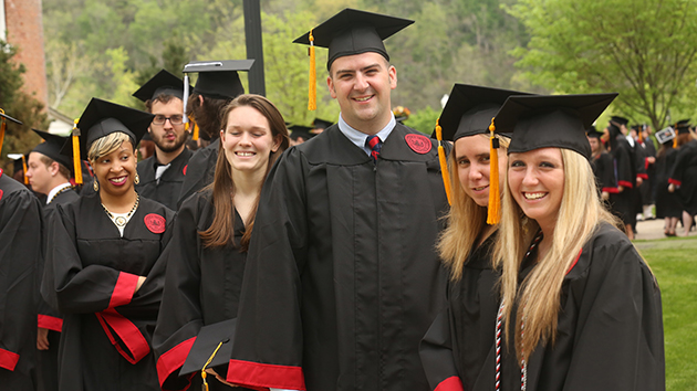Cal U grads stand outside in a group.