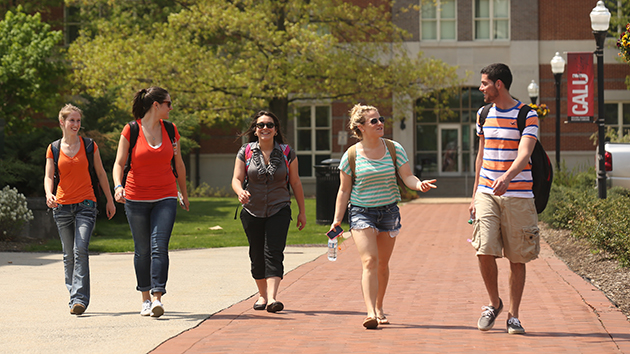 Undergraduate students walk outside of Natali Student Center on Cal U's campus.