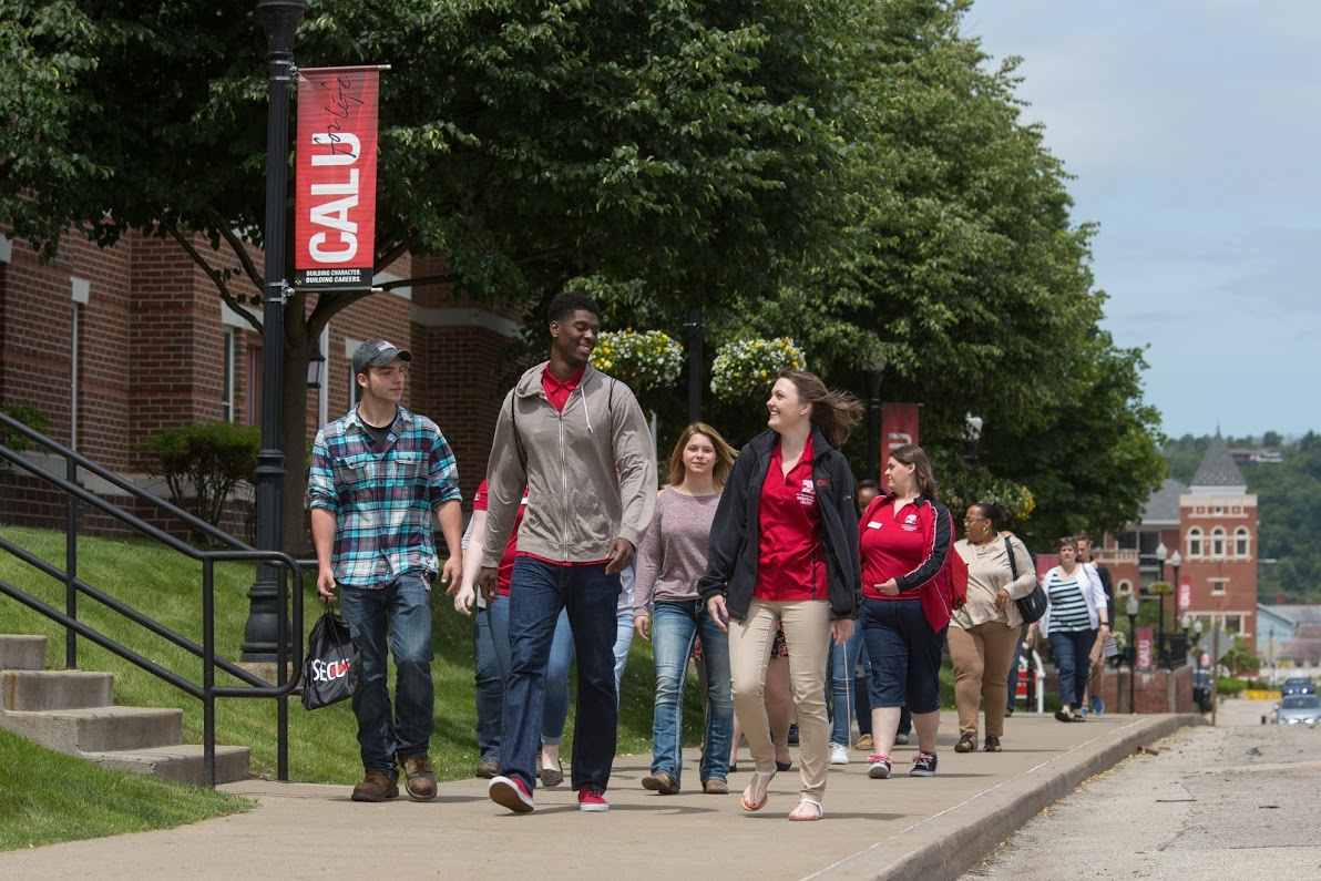 A group of students tour Cal U's campus.