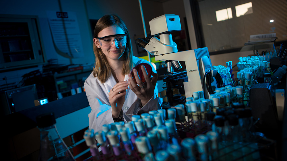 A Cal U student works in a science lab.