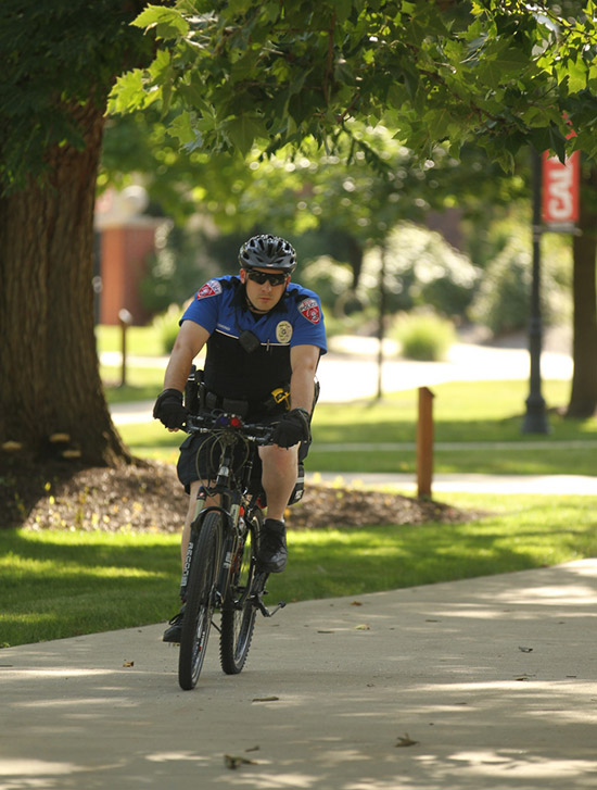 A Cal U policeman rides through campus.