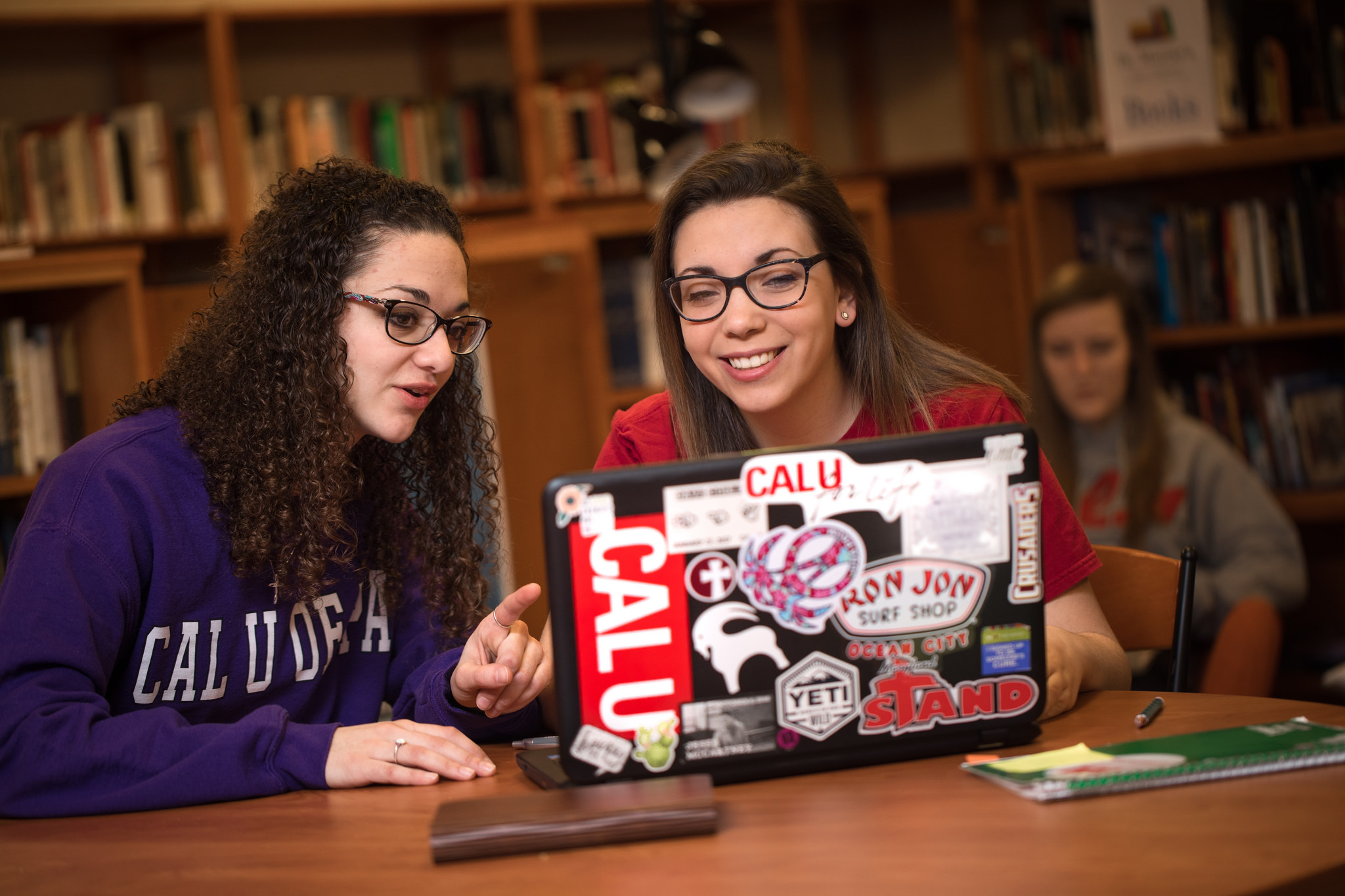 students work together at a computer laptop