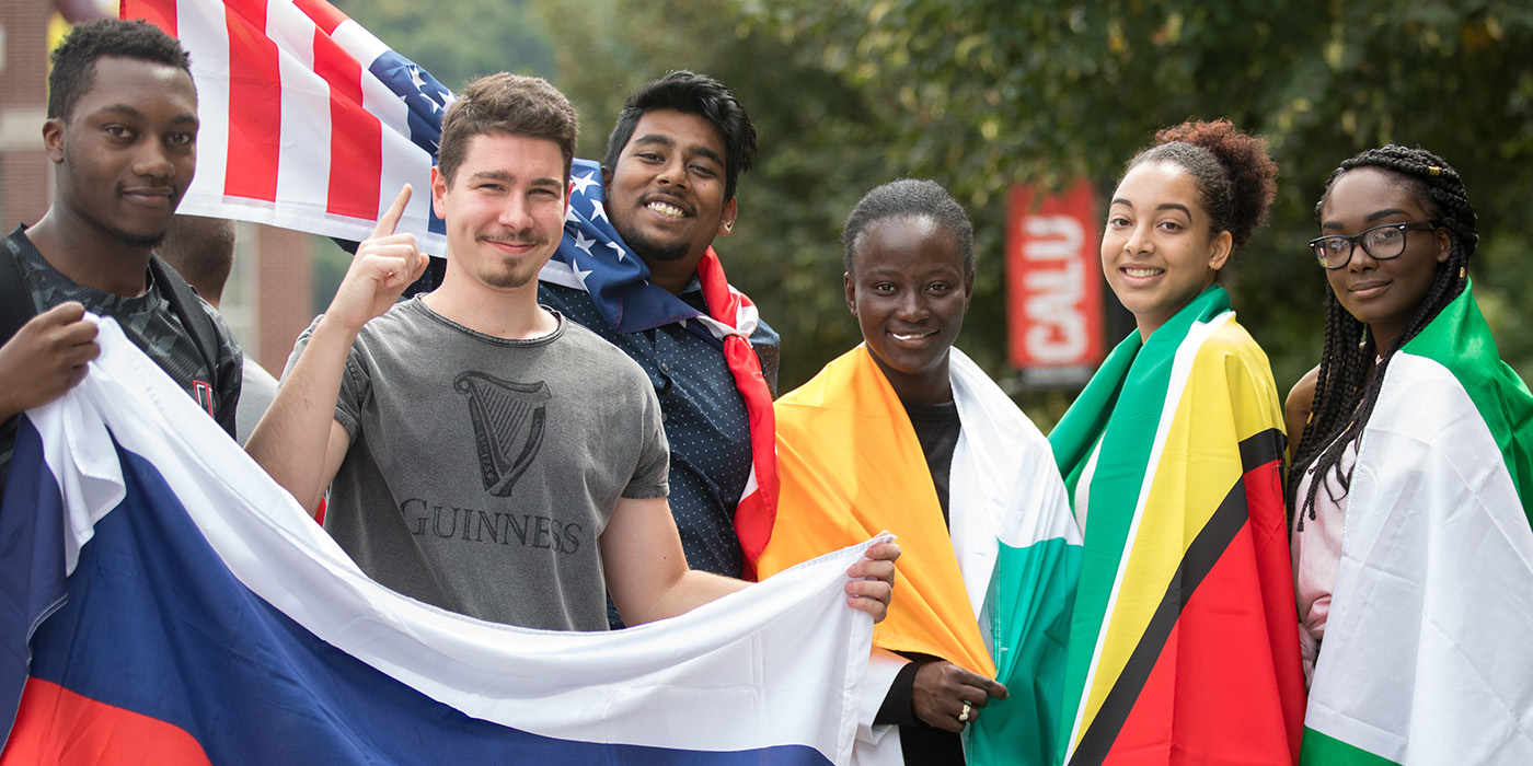 Students in international club wear banners.