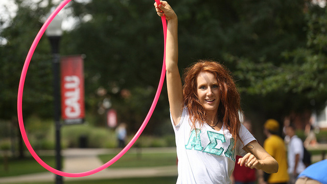 A Cal U Greek student uses a hula hoop.