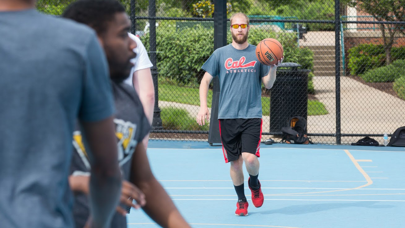 Student play an intramural basketball game at Cal U.
