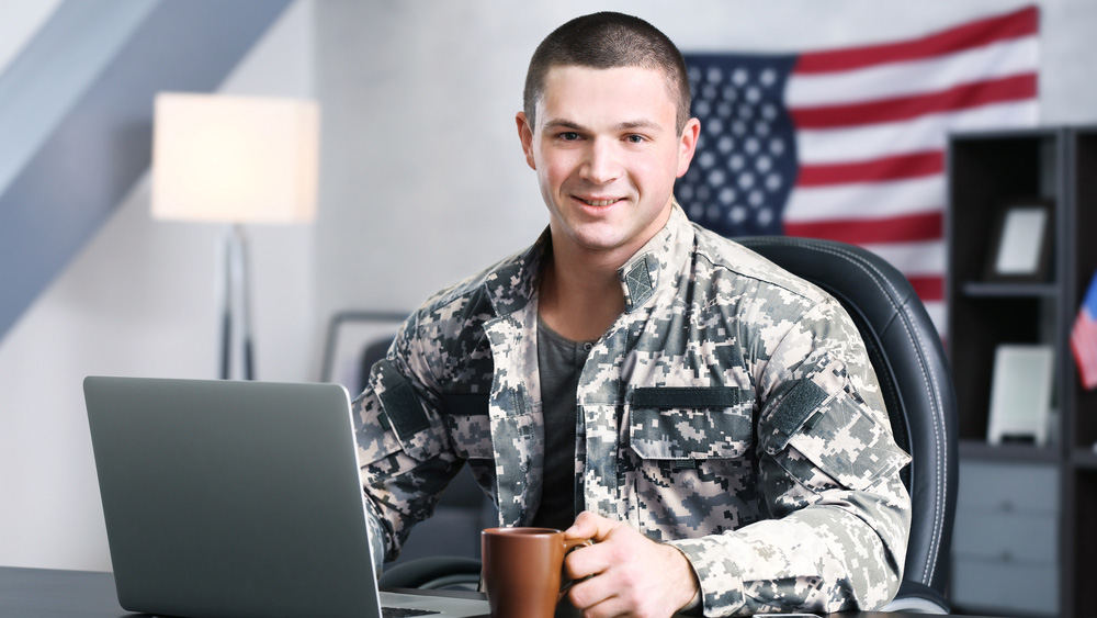 A military student uses a computer for online courses
