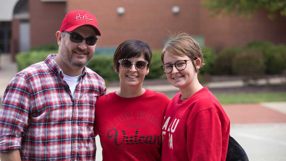 Family poses for picture at Cal U Family Day.